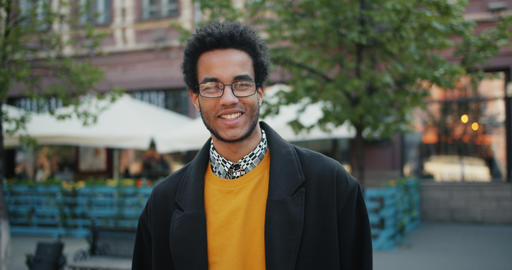 Slow motion portrait of happy African American student smiling standing outdoors Footage