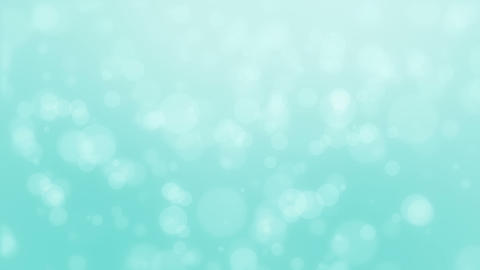 Glowing turquoise blue bokeh background Stock Video Footage
