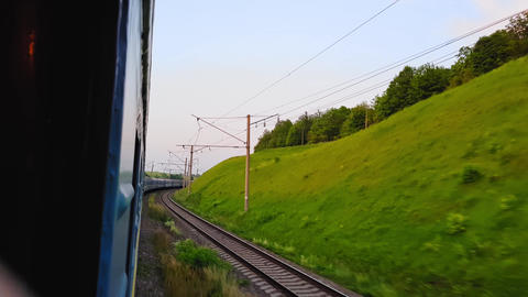 The view from the high-speed train on the beautiful scenery with hills and Live Action