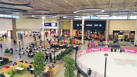 shopping center hall with catering zone ice rink and stores Live Action