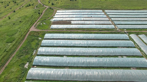 Aerial footage of greenhouses at country side Footage