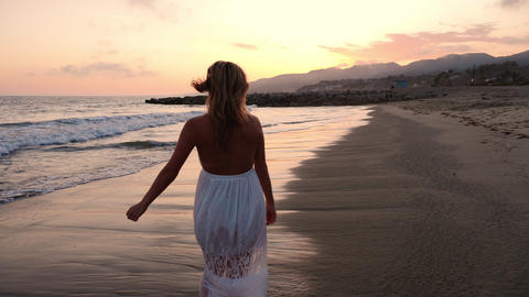 Attractive Woman Enjoying The Beach At Sunset Footage