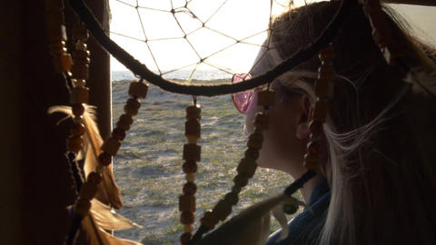 portrait of a young woman in profile in pink glasses in the shape of a heart in Footage