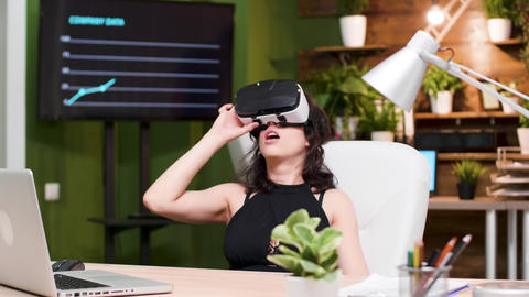 In busy office beautiful girl uses a VR headset Footage