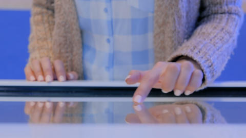 Woman using interactive touchscreen display at technology exhibition Footage