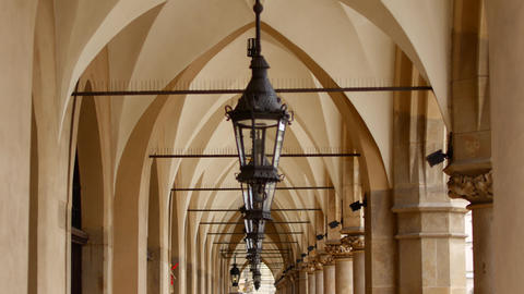 Old lanterns on the alley of arches in Europe Live Action