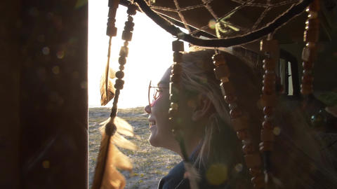 sun rays and glare against the background of a dream catcher swinging in the Footage