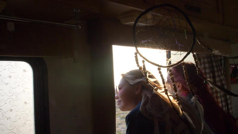 view of the autotrailer window on two women with flowing hair fluttering in the Footage