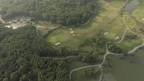 Aerial view of large luxury golf course. View of the green lawns and trees Live Action