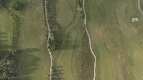Top view of large luxury golf course. View of the green lawns and trees Footage