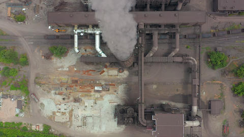 Aerial view. Dirty smoke and smog from pipes of steel factory and blast furnaces Live Action