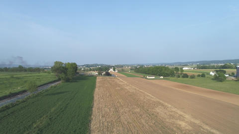 Aerial View of Amish Countryside Waiting for a Steam Locomotive to Arrive Live Action