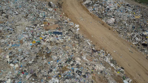 Aerial view of City garbage Dump. Gypsy family with children separates trash to Live Action