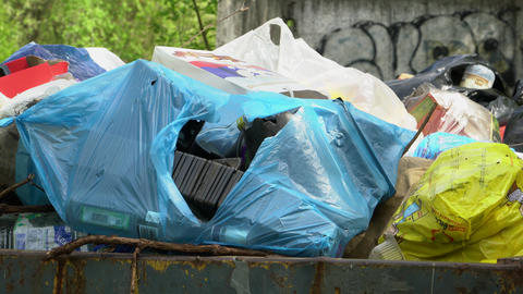 Plastic bags of garbage are in the container Footage