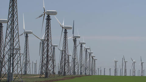 working wind turbines against a blue sky Footage