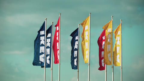 IKEA Swedish multinational furniture & home retail store waving flags Footage
