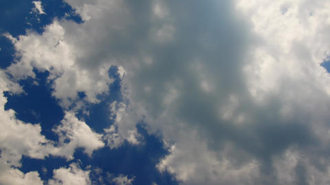Time lapse of floating clouds against the blue sky. Sun through the clouds Live Action