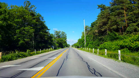 Driving Rural Countryside During Bright Summer Day. Driver Point of View POV Along Beautiful Sunny Footage
