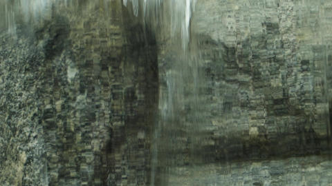 Wall of water spills against a granite wall Stock Video Footage
