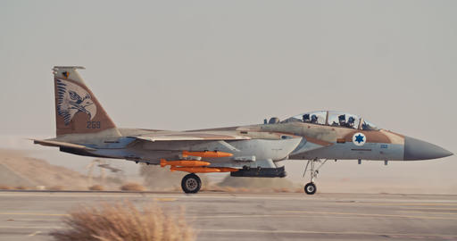 Armed Israeli Air Force F-15 taking off from an airbase with full afterburner Live Action