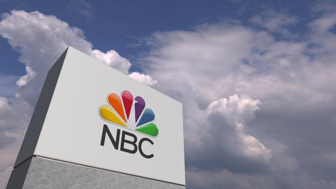 Logo of NBC on a stand against cloudy sky, editorial 3D animation Live Action