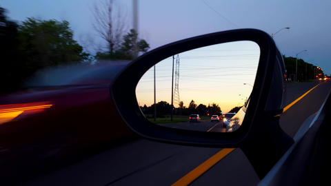 Driving Left Side Mirror During the Evening. Driver Point of View POV Side View Mirror at Night Live Action