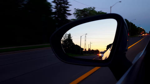 Driving Left Side Mirror During the Evening. Driver Point... Stock Video Footage