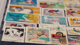 Stamp-collecting. Hobby. Philately. Olympic games Live Action