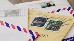 Traditional paper letters with us and canadian stamps Live Action