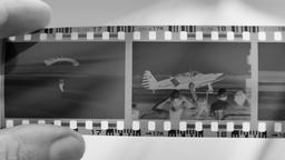 Photographer is watching vintage photographic film strip Live Action