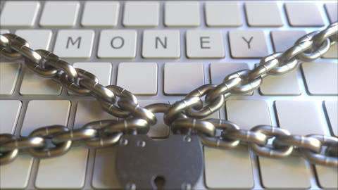 MONEY word on the keyboard with padlock and chains. Conceptual 3D animation Footage