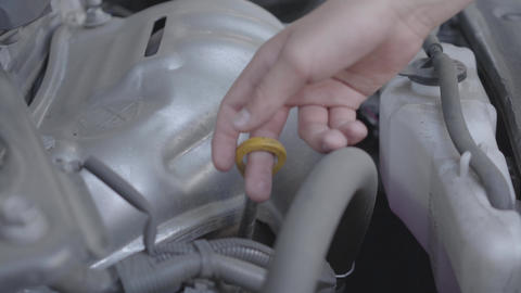 Close-up of hand of the boy checking his car details. Concept of automobile Footage