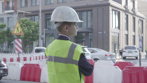 Little boy wearing business suit and safety equipment and constructor helmet Footage