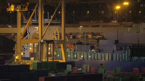A night view of a cargo ship loading at Barcelona port Live Action