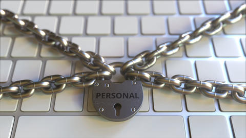 Padlock with PERSONAL text on the computer keyboard. Blocking or restriction Footage