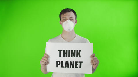 Young Man Activist With mask on face and with Think Planet Poster on chroma key Live Action