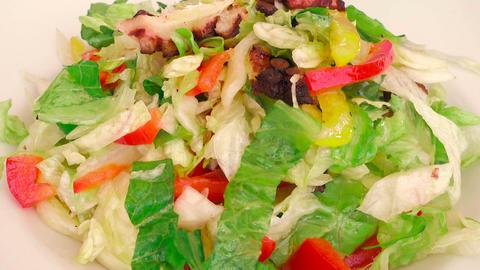 Foodie Dressing a Delicious Octopus Mediterranean Salad Footage