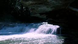 Glistening Waterfall in Underground Cave Footage