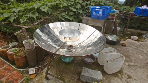 Spherical Mirror to Boil Water in House Yard in Vietnam Footage