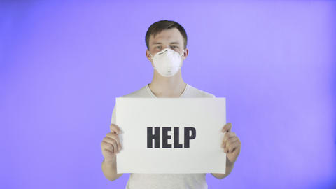 Young Man Activist With mask on face and with HELP Poster on Violet background Live Action