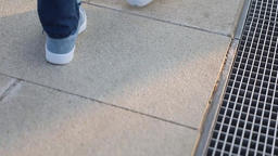 mature man walking in park close-up of sneakers and jeans Footage