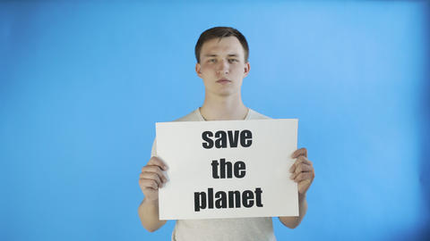 Young Man Activist With Save The Planet Poster on blue background Live Action