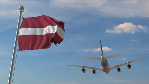 Airliner passing above national flag of Latvia. Latvian air transportation Live Action