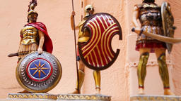 The shelf with Greek hand-made souvenirs - colorful ceramics and figurines of greek gods Footage