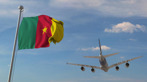 Commercial airplane flying over national flag of Cameroon. Cameroonian air Live Action
