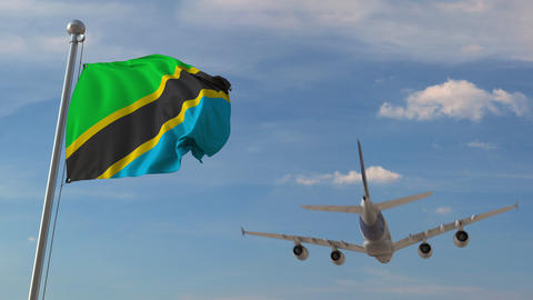 Commercial airplane flying over national flag of Tanzania. Tanzanian air Live Action