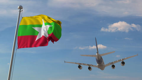 Airplane flying over flag of Myanmar. Myanma tourism related 3D animation Live Action