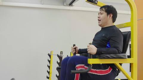 Asian fat man trying to exercise in fitness gym, Healthy lifestyle, weight loss desire Live Action