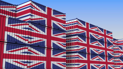Container terminal full of containers with flag of the United Kingdom. British Live Action