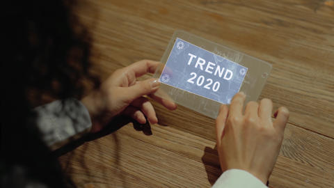 Hands hold tablet with text Trend 2020 Footage